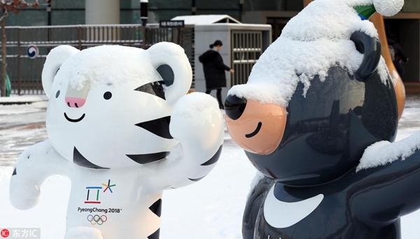 平昌吉祥物迎冬戴雪帽